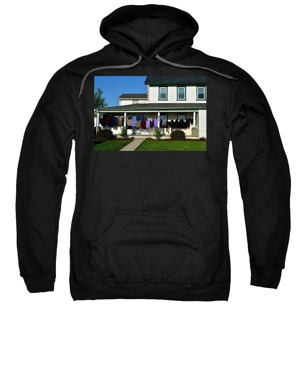 Amish Sweatshirt featuring the photograph Colorful Amish Laundry On Porch by Tana Reiff