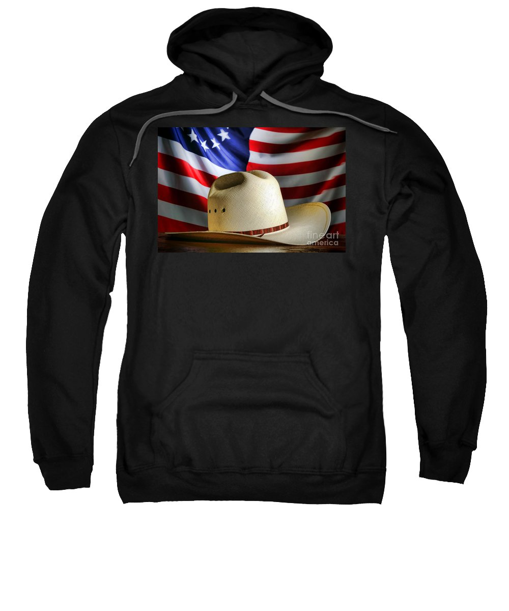 American Sweatshirt featuring the photograph Cowboy Hat And American Flag by Olivier Le Queinec
