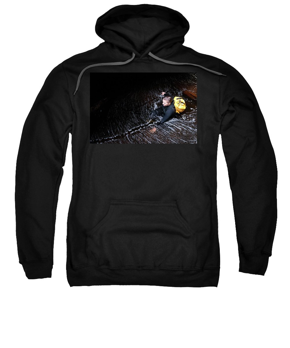 35-39 Years Sweatshirt featuring the photograph Female Canyoner Wading Through A Pool by Thomas Pickard