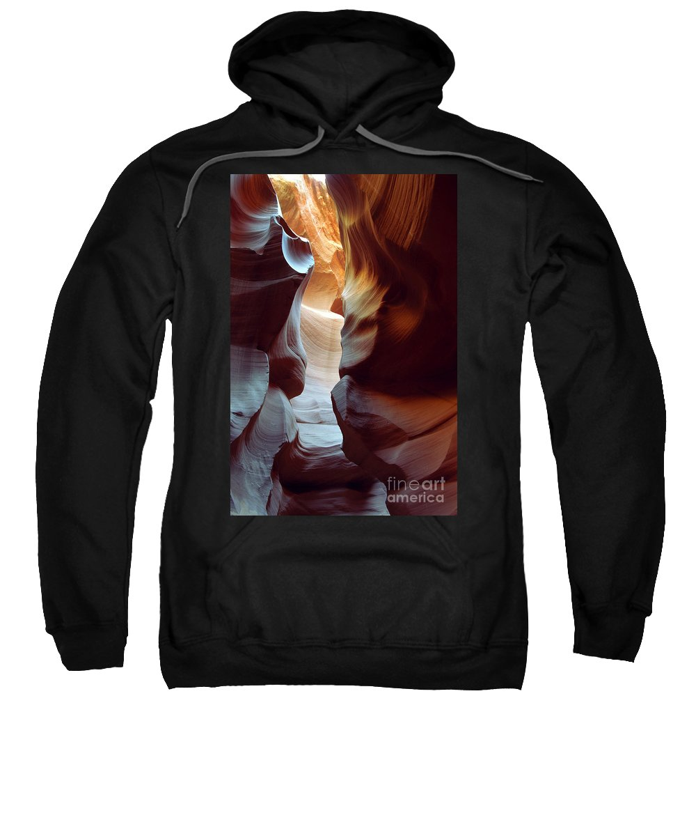 Slot Canyon Sweatshirt featuring the photograph Follow the Light II by Kathy McClure