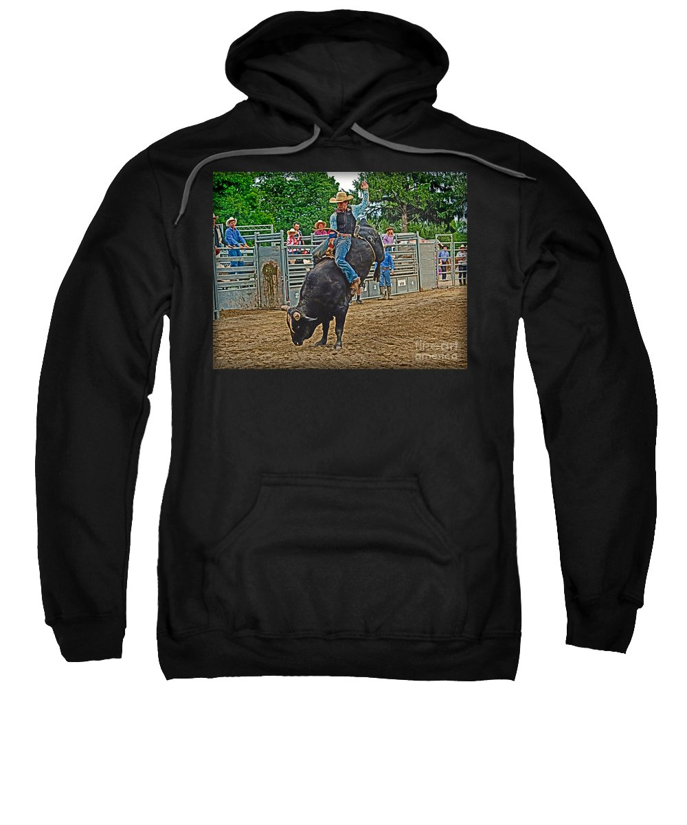Cowboy Sweatshirt featuring the photograph Hanging-on by Gary Keesler