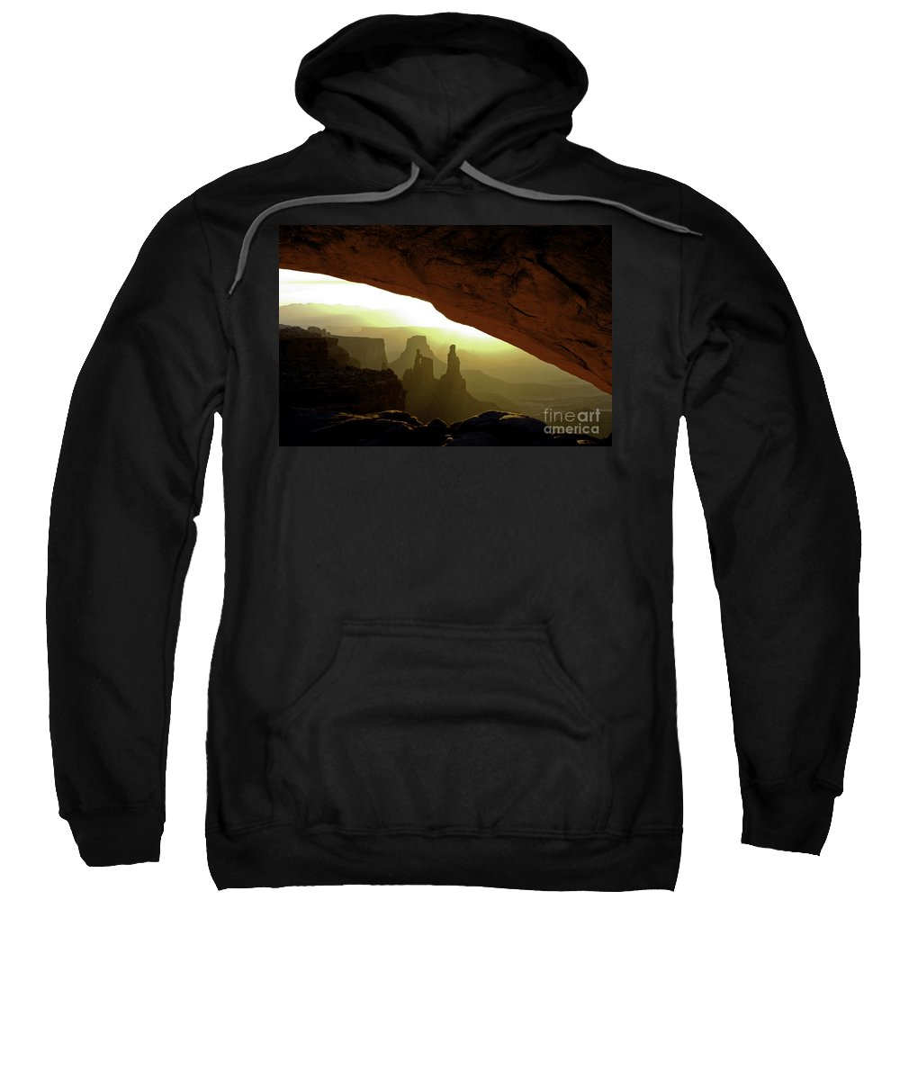 Mesa Arch Canyonlands National Park Utah Arches Sunrise Sunrises Red Rock Formation Formations Parks Reflected Light Early Morning Dawn Landscape Landscapes Landmark Landmarks Sweatshirt featuring the photograph Mesa Arch At Sunrise by Bob Phillips
