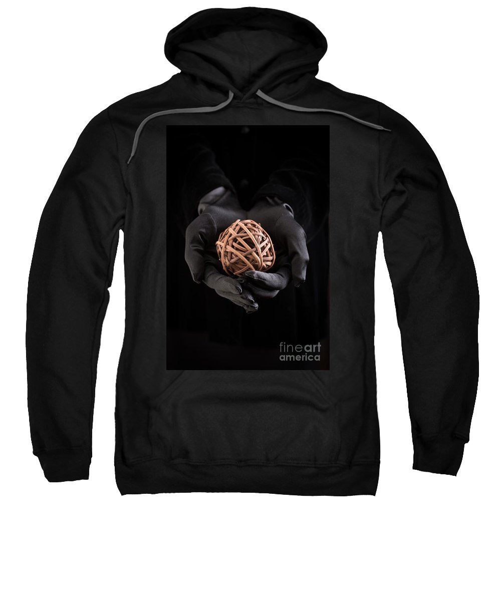 Book Sweatshirt featuring the photograph Mystical Hands Holding A Woven Ball by Edward Fielding