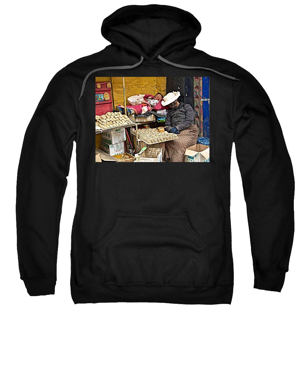 Nap Time For Child And Street Shopkeeper In Lhasa Sweatshirt featuring the photograph Nap Time For Child And Street Shopkeeper In Lhasa-tibet  by Ruth Hager