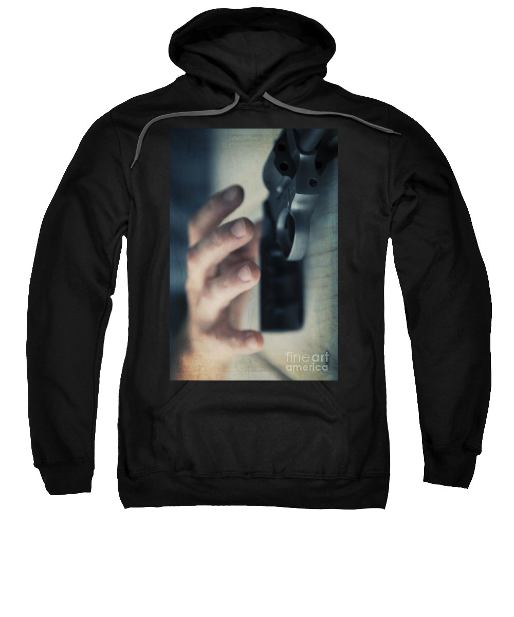 Angle Sweatshirt featuring the photograph Reaching For A Gun by Edward Fielding