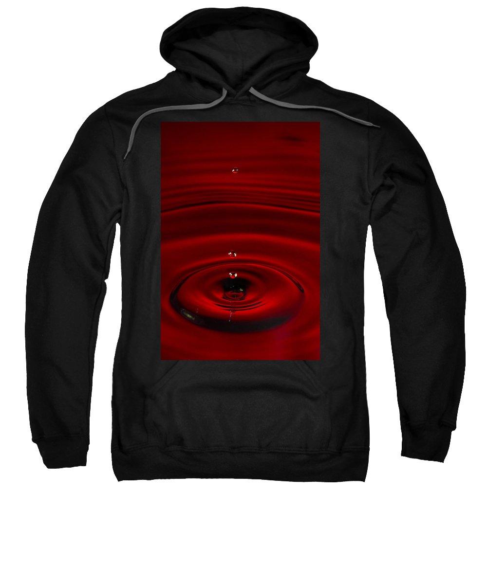 Drop Sweatshirt featuring the photograph Red Drop by Agustin Uzarraga