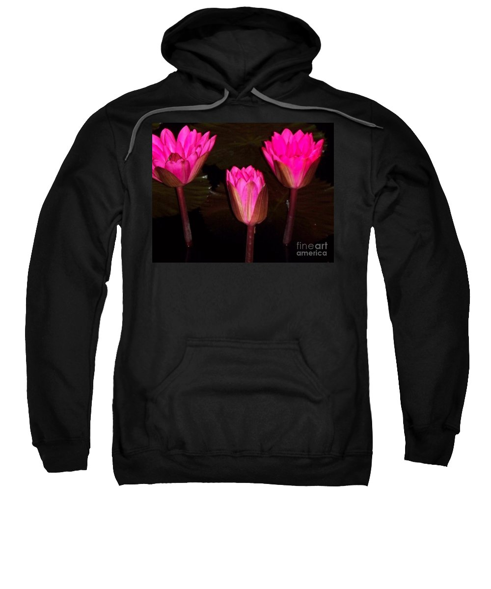 Red Sweatshirt featuring the photograph Red Lilies At Night by Eric Schiabor