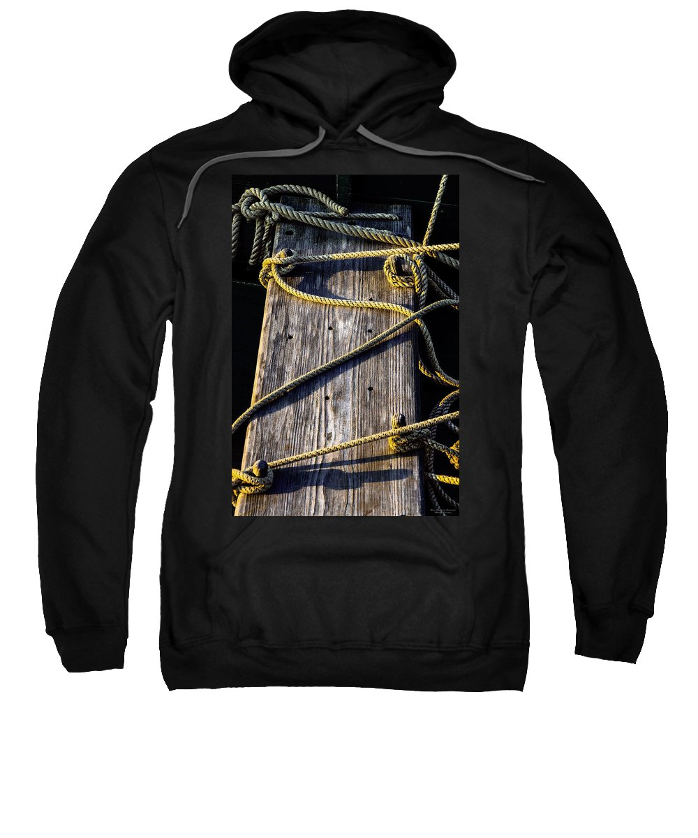 Rope And Wood Sidelight Textures Sweatshirt featuring the photograph Rope And Wood Sidelight Textures by Marty Saccone