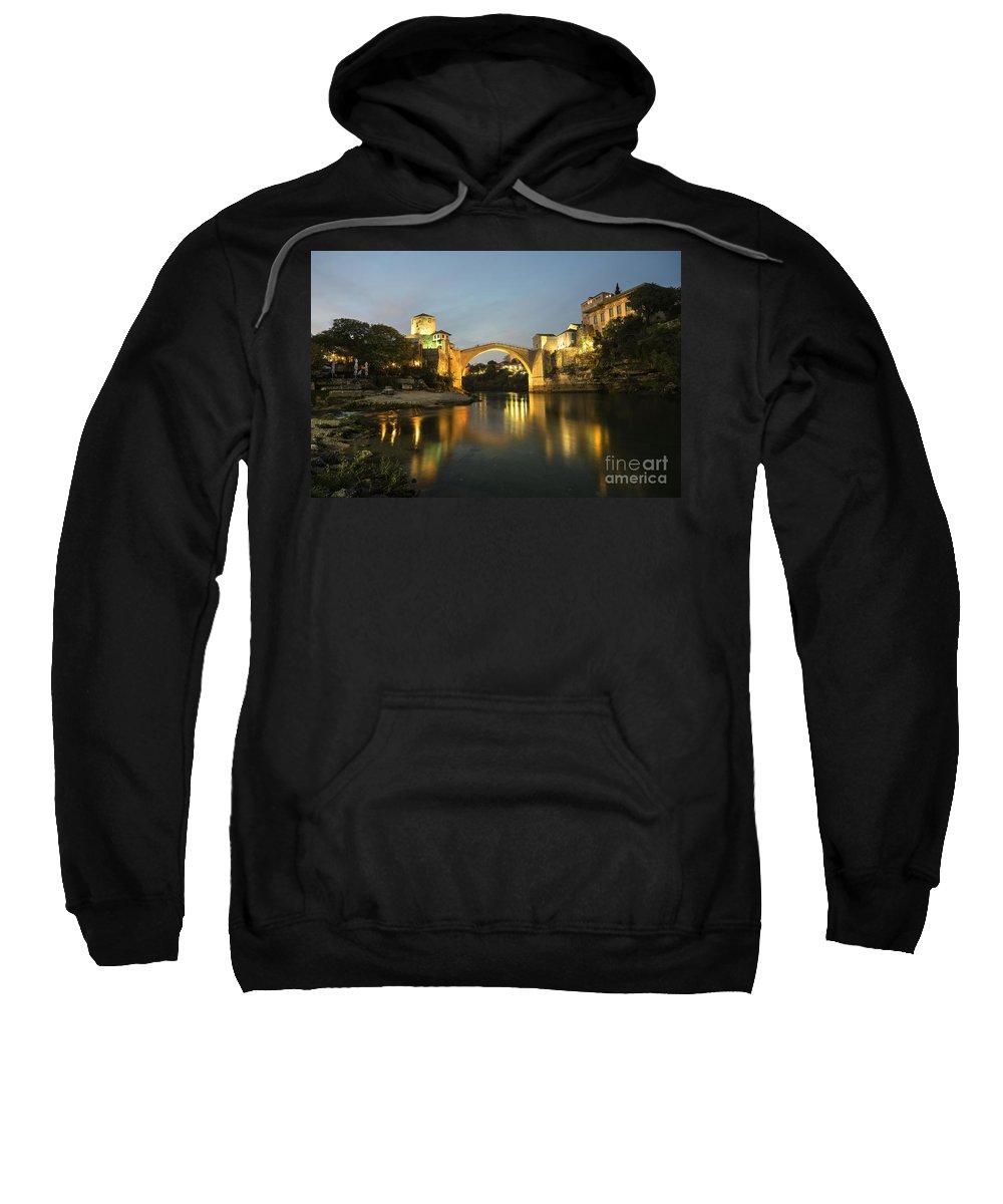 Stari Sweatshirt featuring the photograph Stari Most By Night by Rob Hawkins