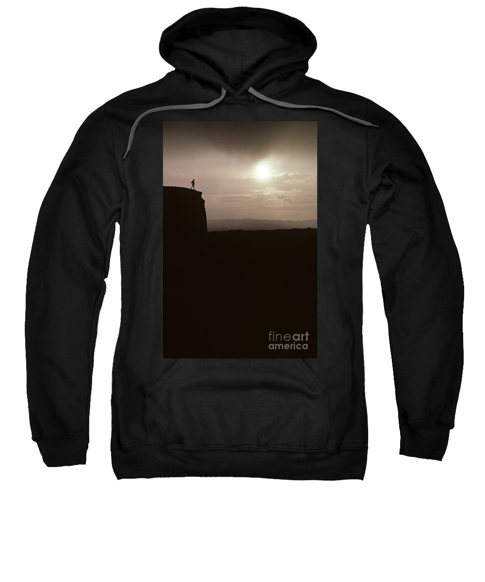 Landscape Sweatshirt featuring the photograph Sunset Arches National Park With Silhouetted Man On Ridge With S by Jim Corwin