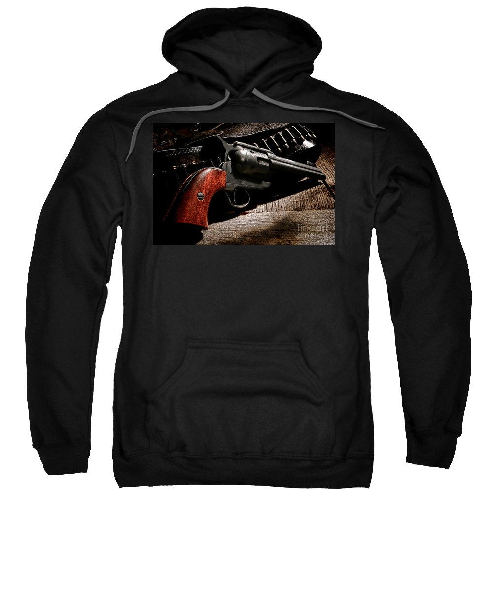 Revolver Sweatshirt featuring the photograph The Gun That Won The West by Olivier Le Queinec