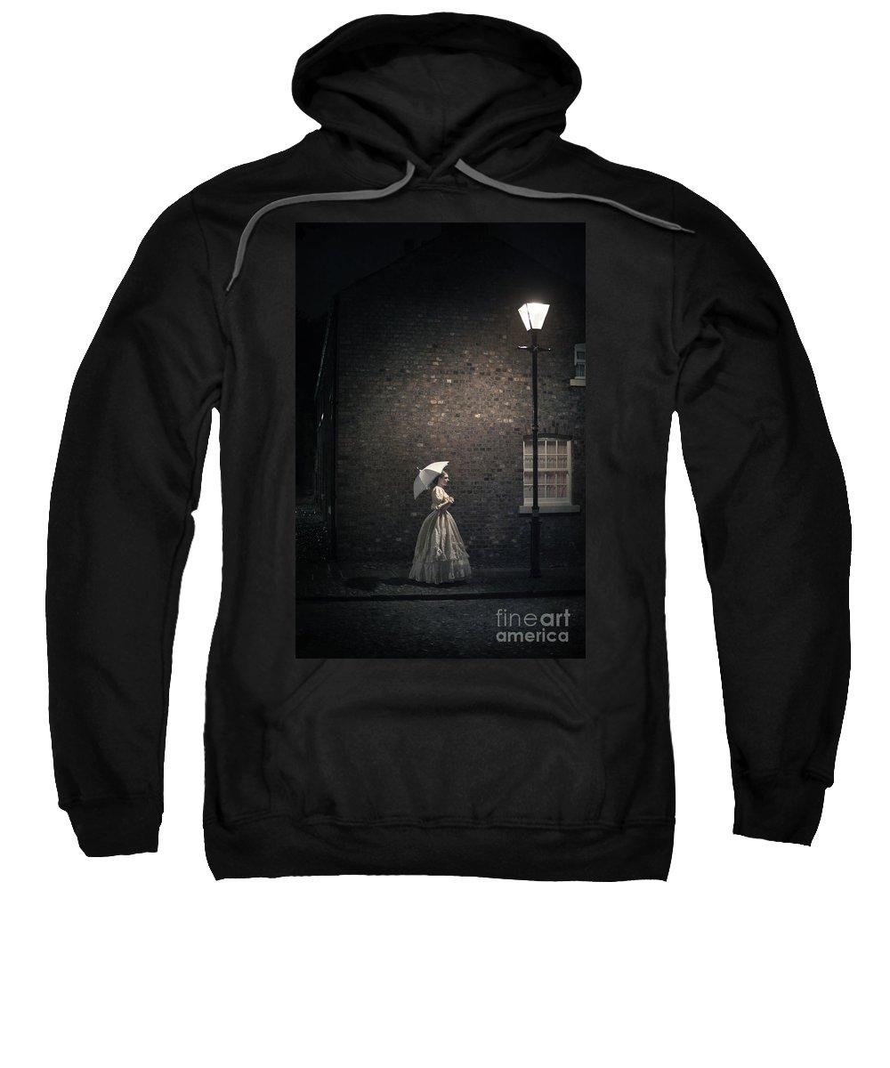 Victorian Sweatshirt featuring the photograph Victorian Woman Beneath A Street Lamp by Lee Avison