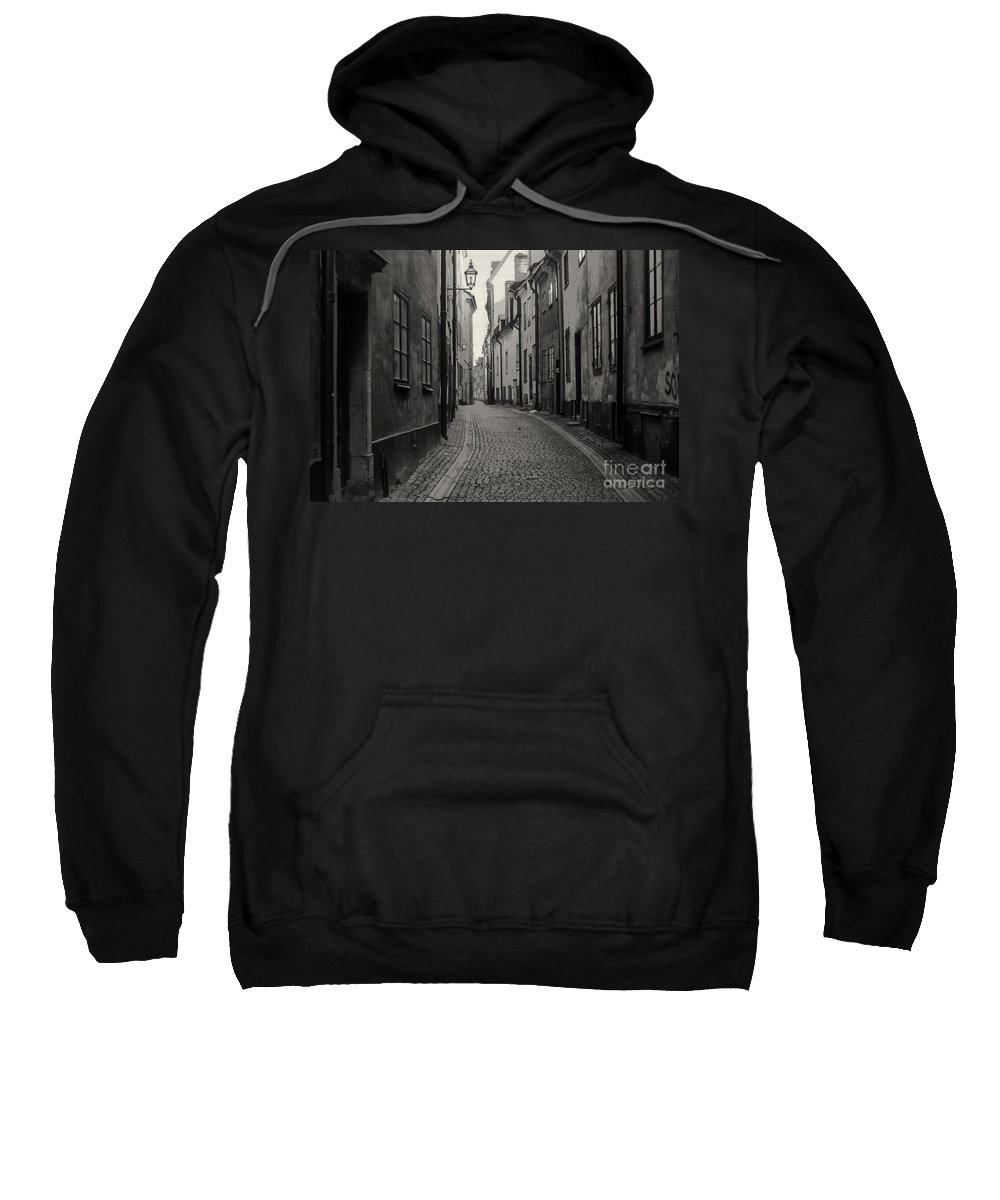 Cobblestone Street Streets Cobblestones City Cities Cityscape Cityscapes Building Buildings Structure Structures Architecture Door Doors Window Windows Black And White Sepia Stockholm Sweden Sweatshirt featuring the photograph Where Have All The People Gone 3 by Bob Phillips