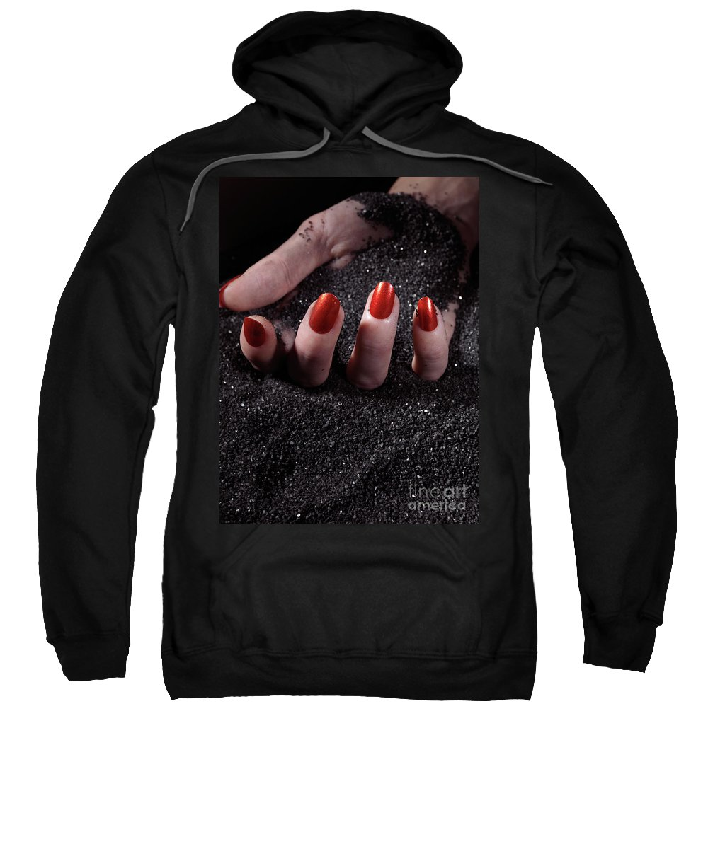 Manicure Sweatshirt featuring the photograph Woman Hand With Red Nails On Black Sand by Oleksiy Maksymenko