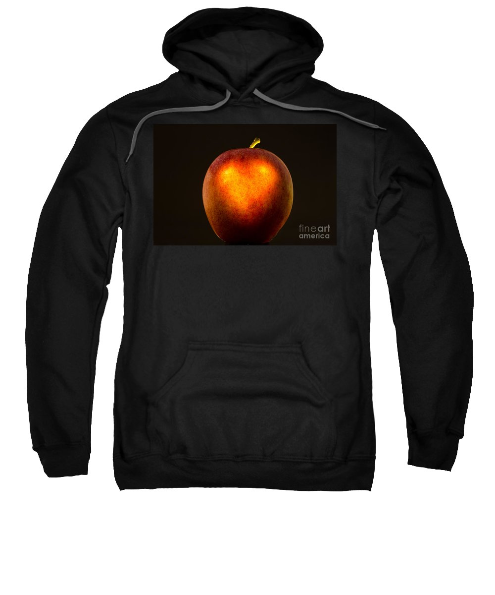 Apple Sweatshirt featuring the photograph Apple With A Illuminated Heart by Mats Silvan