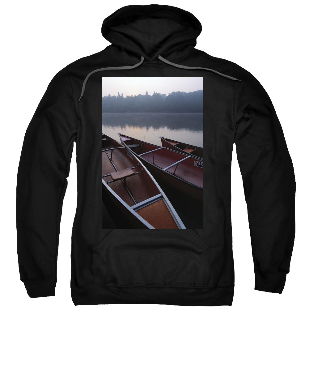 Canoe Sweatshirt featuring the photograph Canoes On Still Water by Natural Selection John Reddy