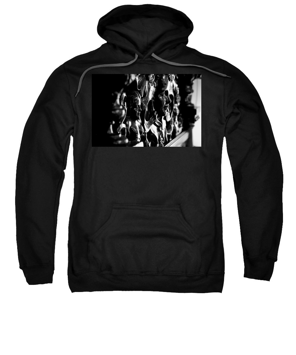 Wood Carving Sweatshirt featuring the photograph Carved Faces by Eric Tressler