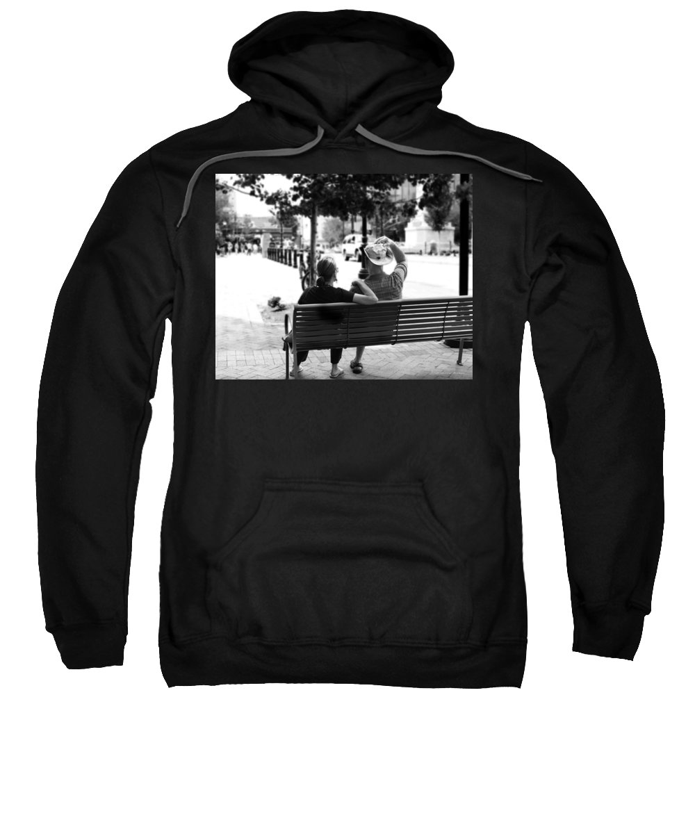 Couple Sweatshirt featuring the photograph Couple Resting On A Downtown Bench On A Windy Day by Gray Artus