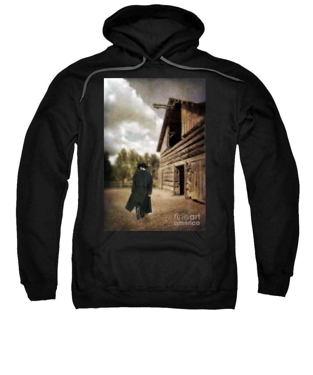 Cowboy Boots Sweatshirt featuring the photograph Cowboy Walking By Barn by Jill Battaglia