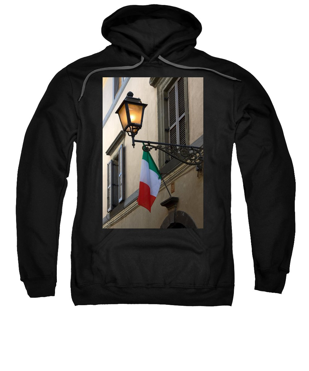 Lighted Anique Wall Light Sweatshirt featuring the photograph Lamp And Flag by Sally Weigand