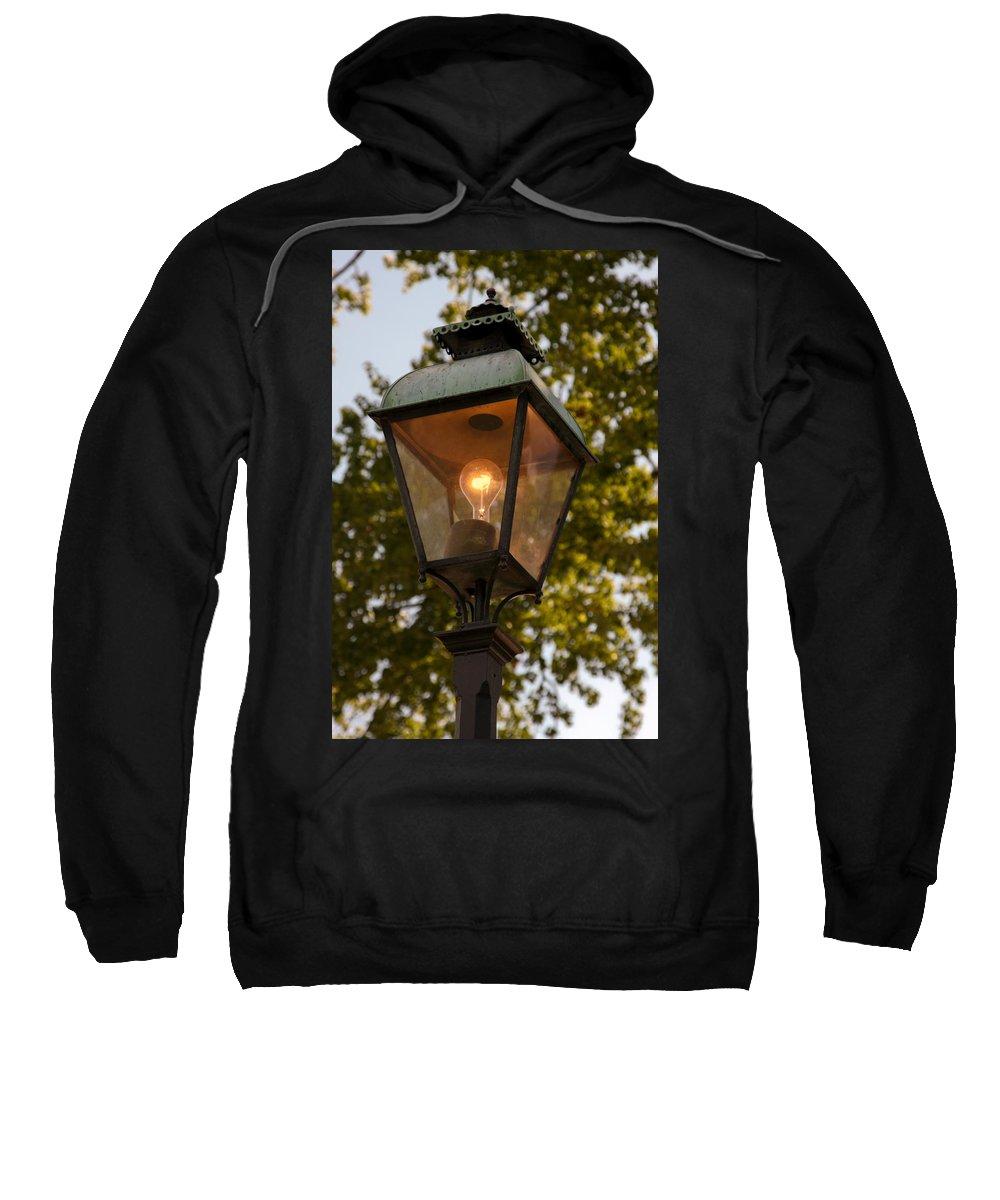 Lighted Street Lamppost Sweatshirt featuring the photograph Lighted Street Lamppost by Sally Weigand