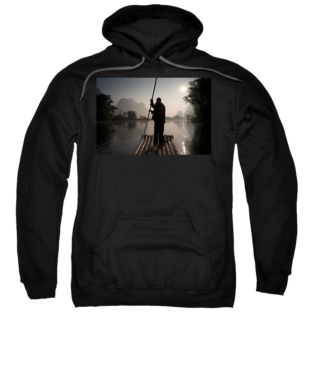 China Sweatshirt featuring the photograph Man On Raft In Mountain Area Yulong by Keith Levit