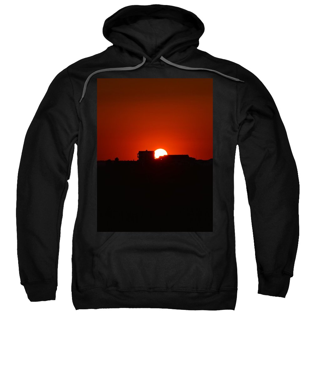 Deep Red Sunset Architecture Background Beautiful Beauty Black Bright Building Color Colorful Contour Dawn Dusk Evening Gold Golden Horizon Landscape Light Nature Night Orange Outdoor Outline Red Scene Scenic Shadow Silhouette Sky Skyline Sun Sunlight Sunny Sunrise Sunset Sunshine Tourism Travel Twilight View Sweatshirt featuring the photograph Red Skies At Night by William Bartholomew
