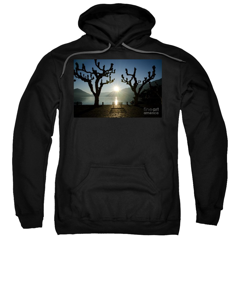 Bench Sweatshirt featuring the photograph Sunset Over A Lake With Trees by Mats Silvan