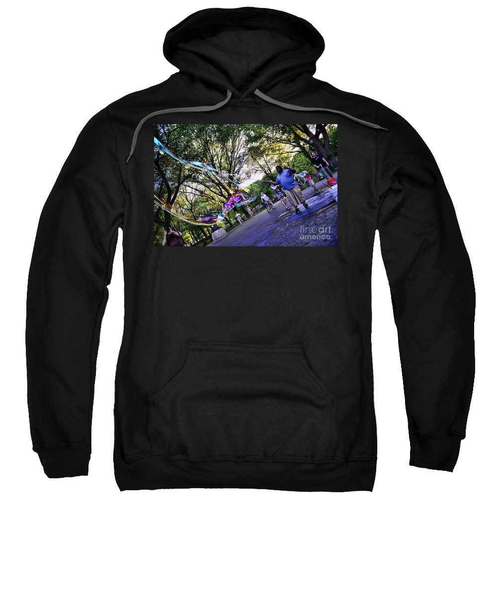 The Bubble Man Of Central Park Sweatshirt featuring the photograph The Bubble Man Of Central Park by Paul Ward