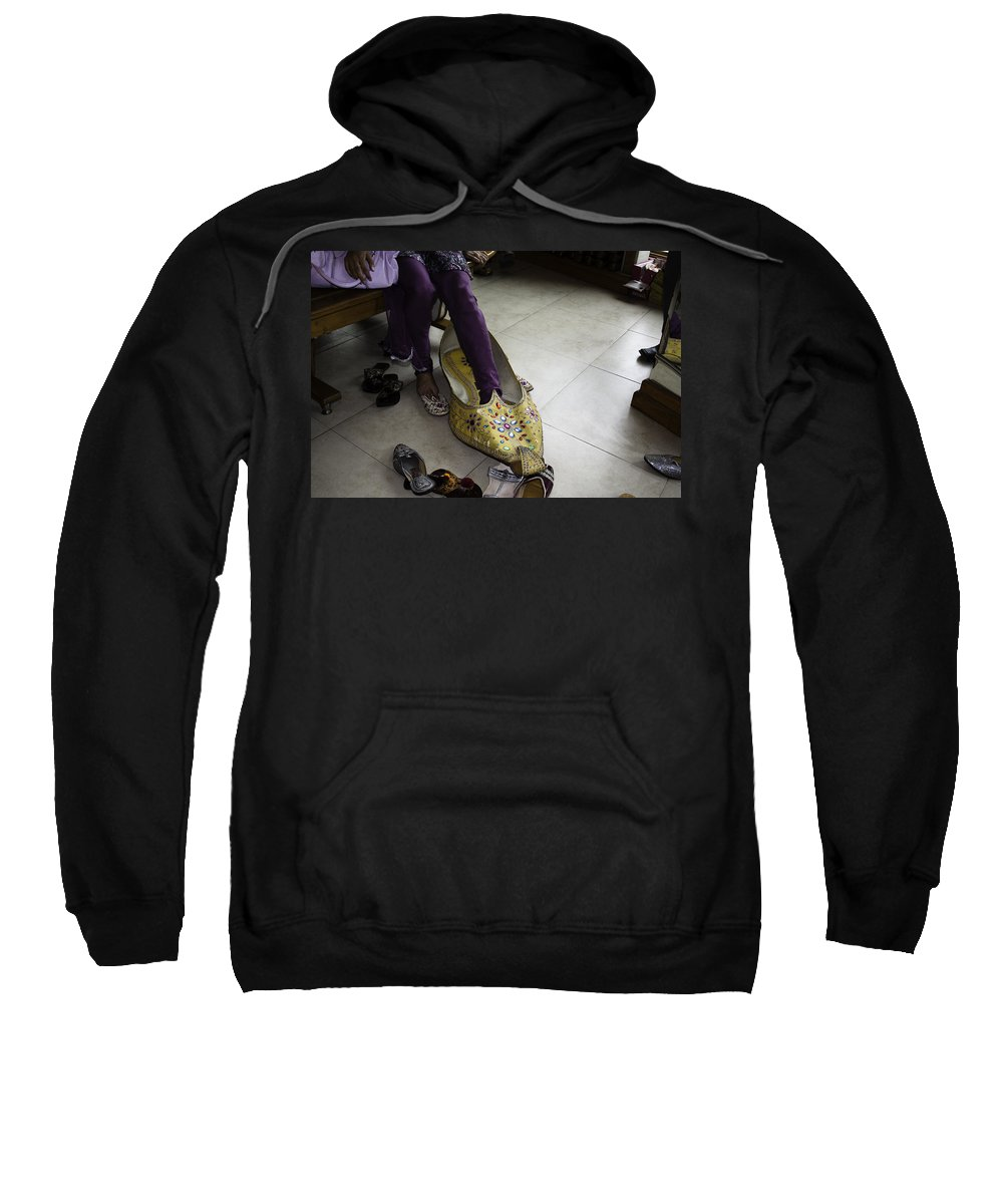 Amritsar Sweatshirt featuring the photograph Trying On A Very Large Decorated Shoe by Ashish Agarwal