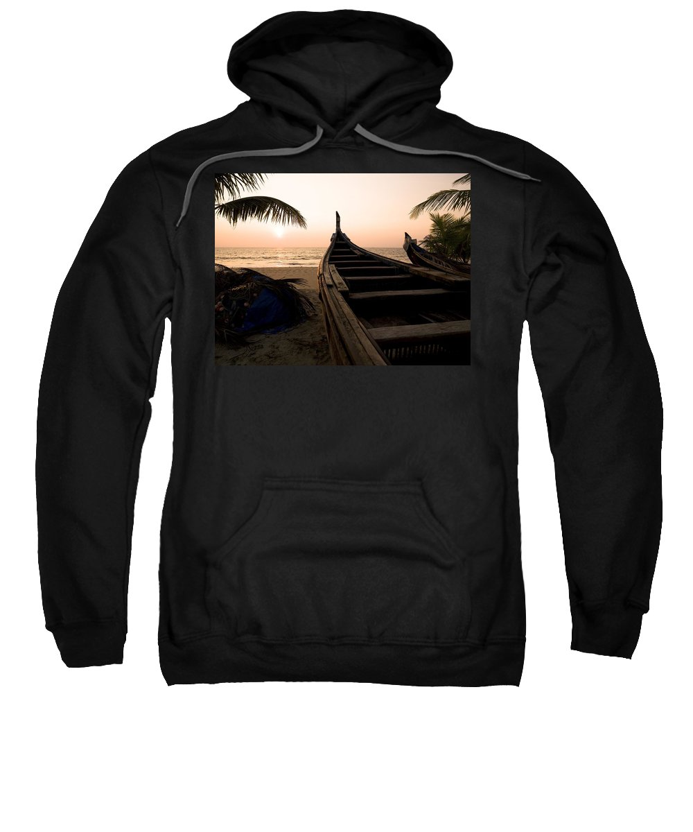 Arabian Sweatshirt featuring the photograph Two Canoes On The Beach At The Arabian by Keith Levit