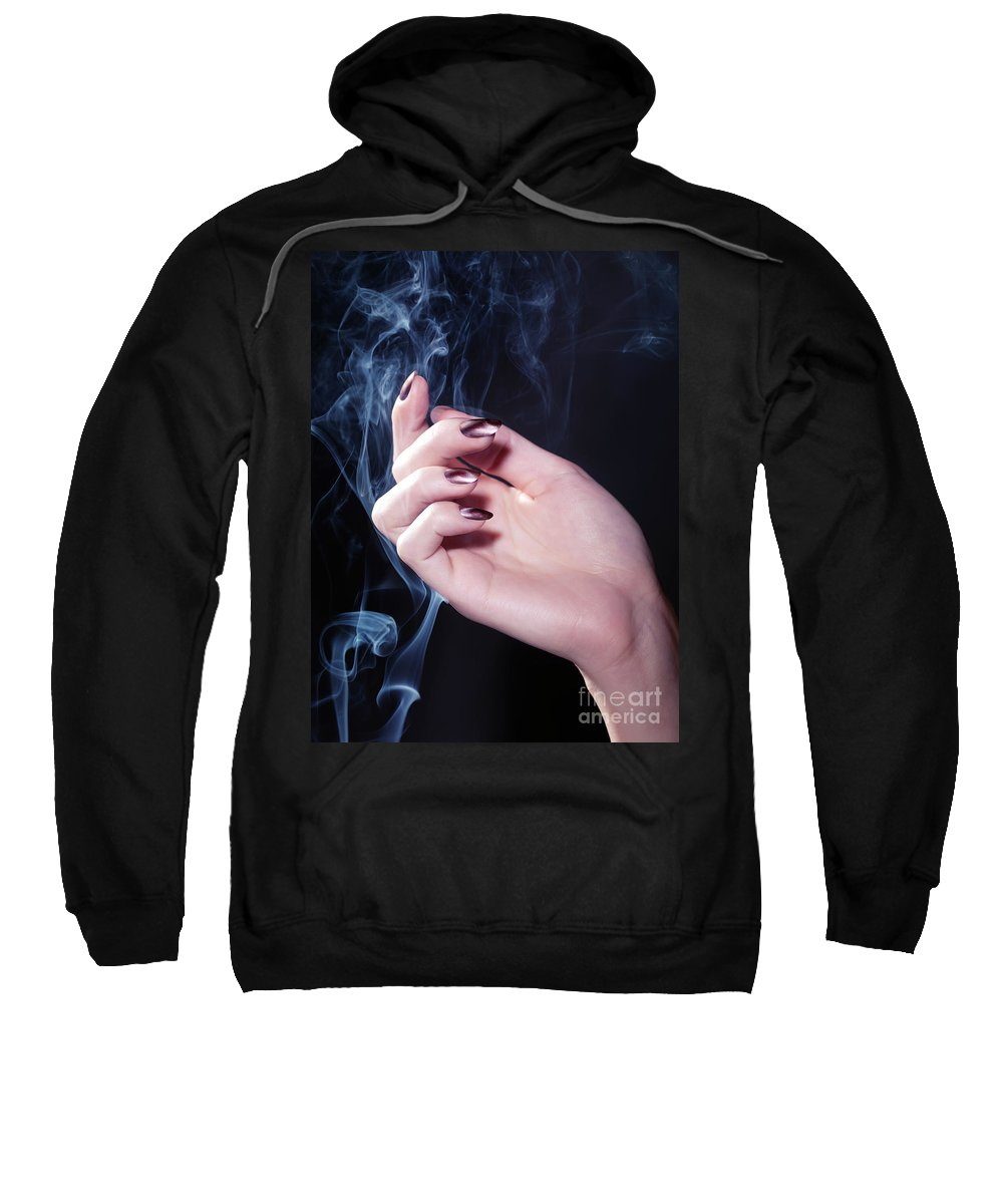 Nail Polish Sweatshirt featuring the photograph Woman Hand In A Stream Of Smoke by Oleksiy Maksymenko