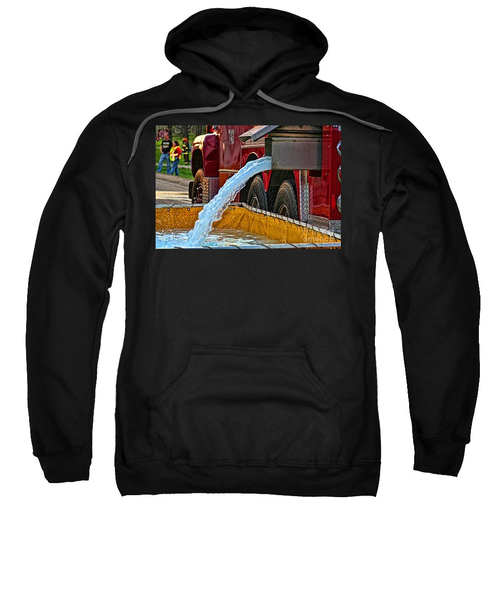 Firefighting Sweatshirt featuring the photograph Water Dump by Tommy Anderson