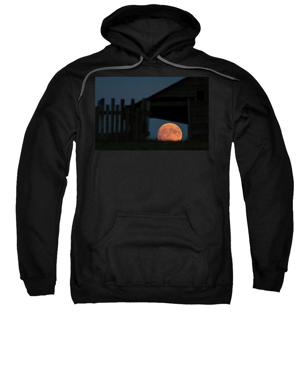 Full Moon Sweatshirt featuring the digital art Full Moon Seen Through Old Building Window by Mark Duffy