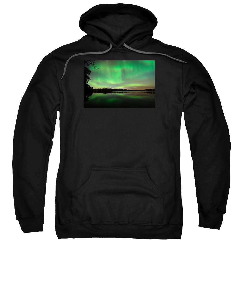 Aurora Borealis Sweatshirt featuring the photograph Aurora Over Tofte Lake by Larry Ricker