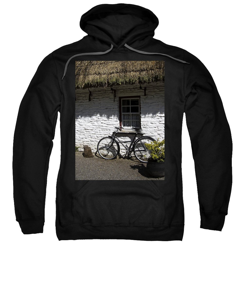 Irish Sweatshirt featuring the photograph Bike At The Window County Clare Ireland by Teresa Mucha