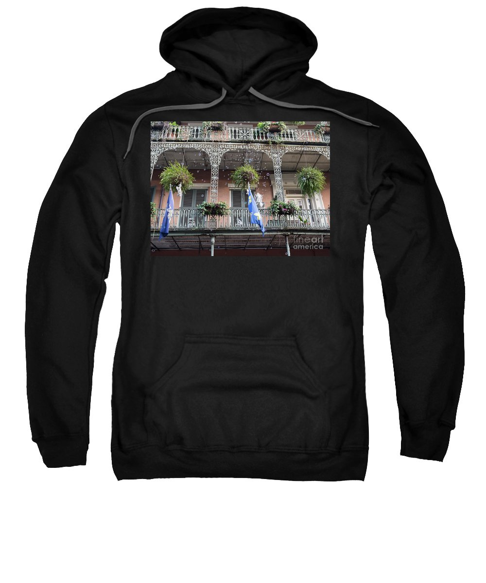 Wrought Iron Sweatshirt featuring the photograph Bubbles Blow From An Ornate Balcony In New Orleans At Mardi Gras by Louise Heusinkveld