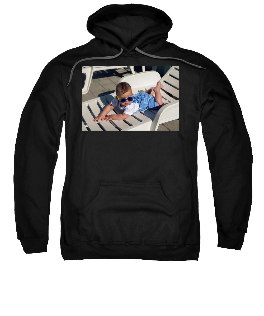 Lying Sweatshirt featuring the photograph Child In A Denim Suit And Sunglasses Lying by Elena Saulich