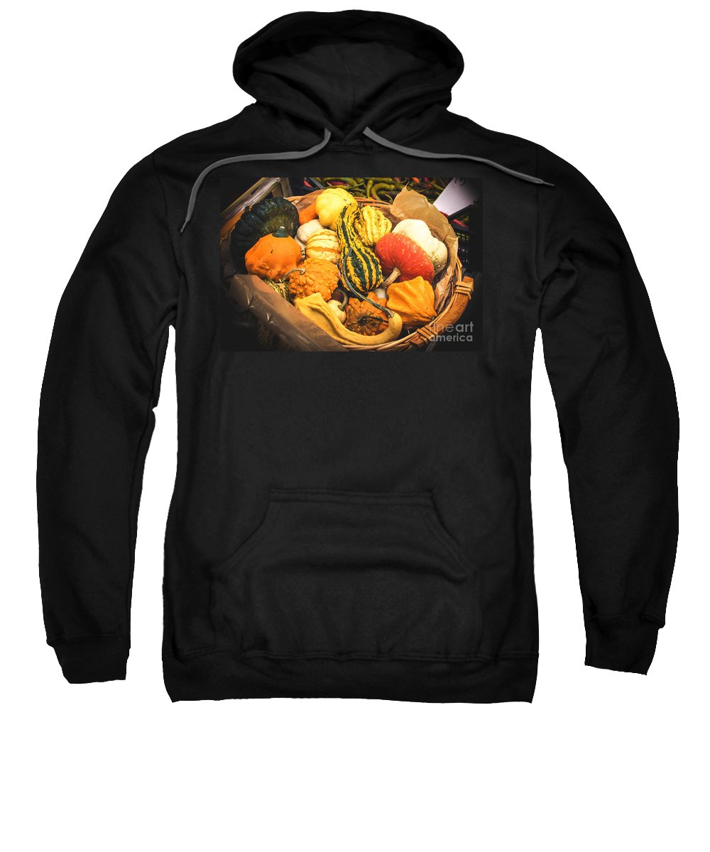 Agriculture Sweatshirt featuring the photograph Composition Of Various Gourds In A Basket With Vignetting by Luca Lorenzelli