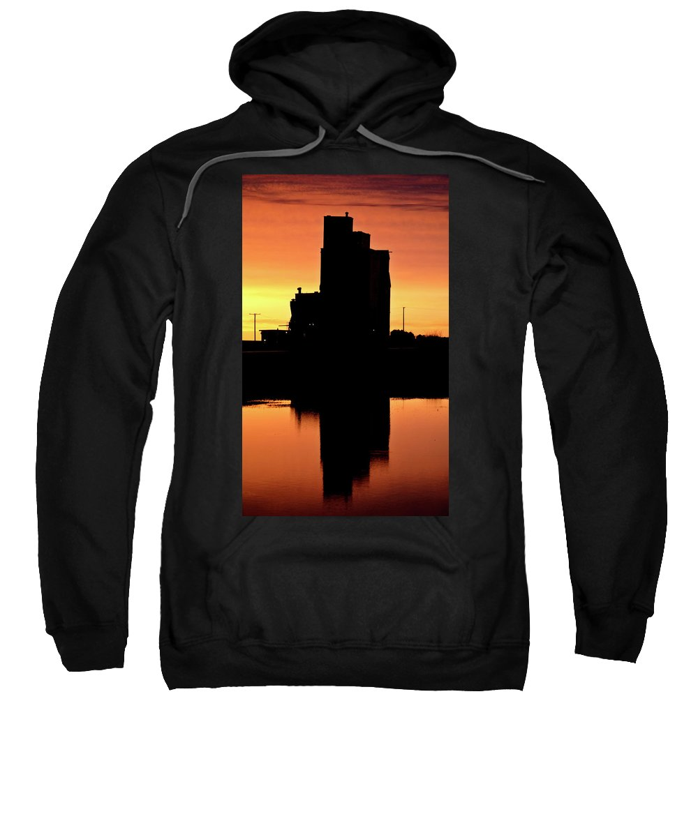 Twilight Sweatshirt featuring the digital art Eyebrow Gain Elevator Reflected Off Water After Sunset by Mark Duffy