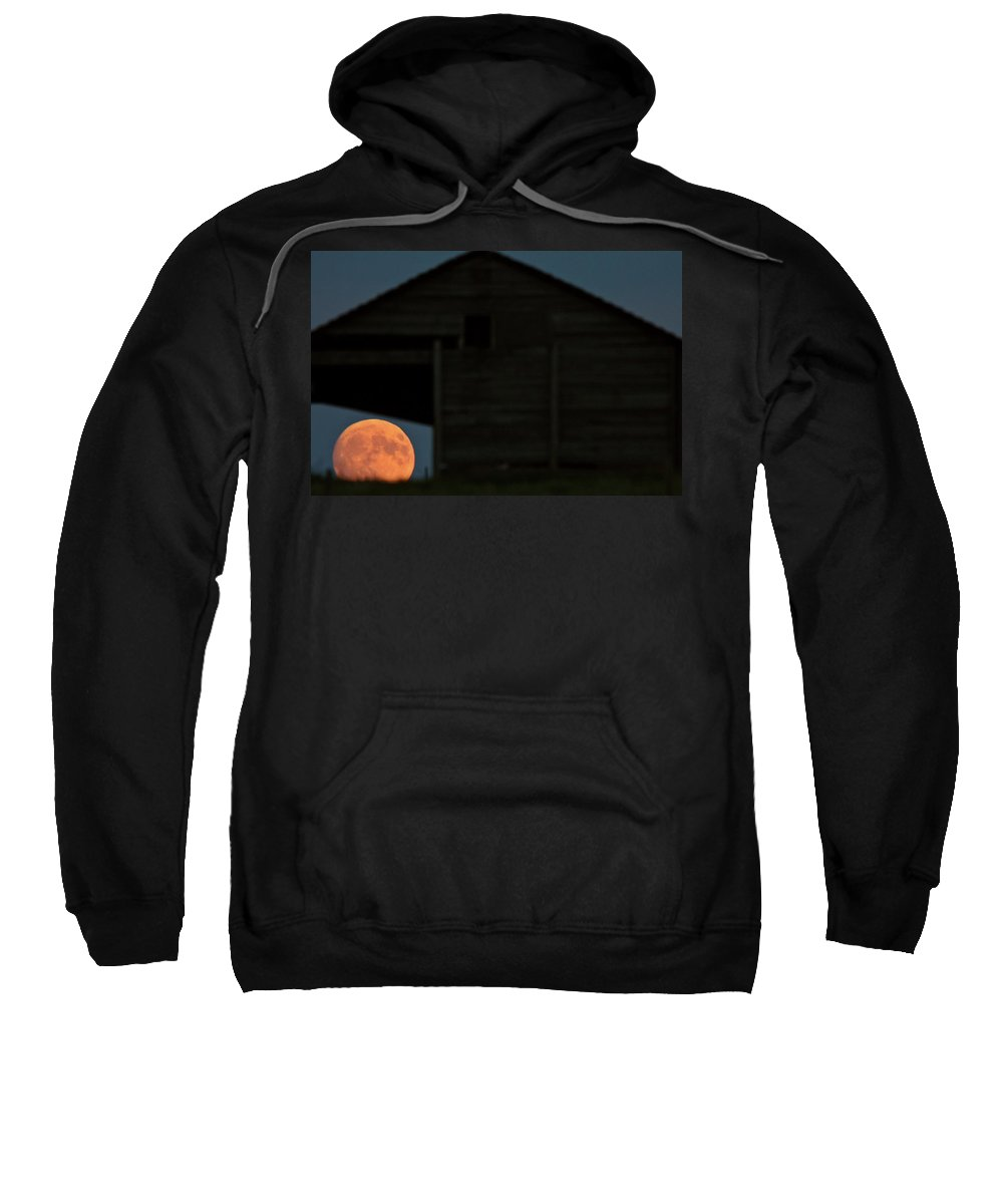 Building Sweatshirt featuring the digital art Full Moon Seen Through Old Building Window by Mark Duffy