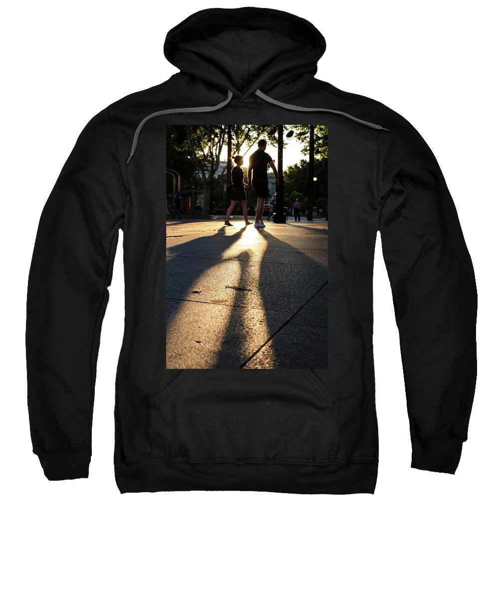 Holding Sweatshirt featuring the photograph Hands In Sunset by Andrea Mazzocchetti