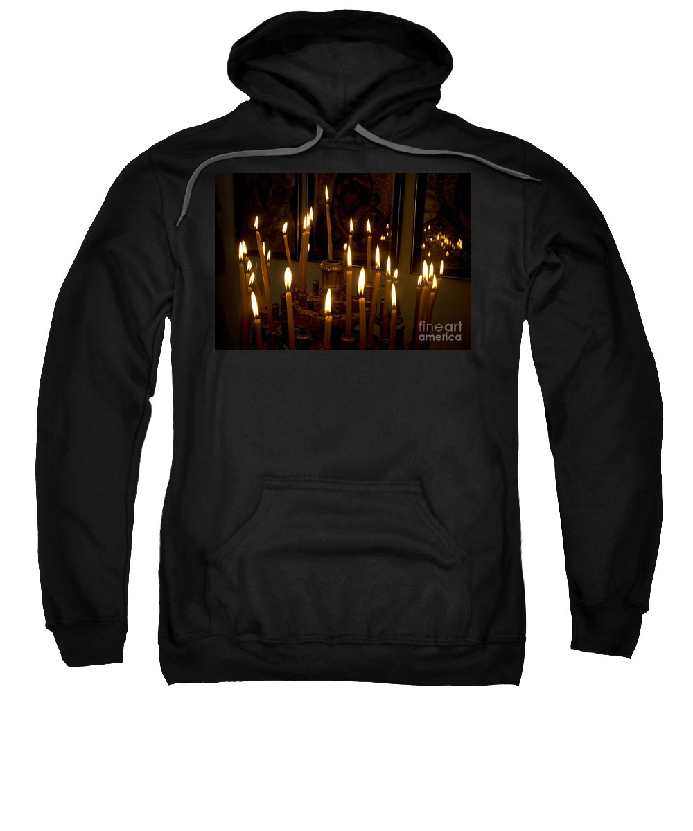 Lit Sweatshirt featuring the photograph lit Candles in church by Danny Yanai