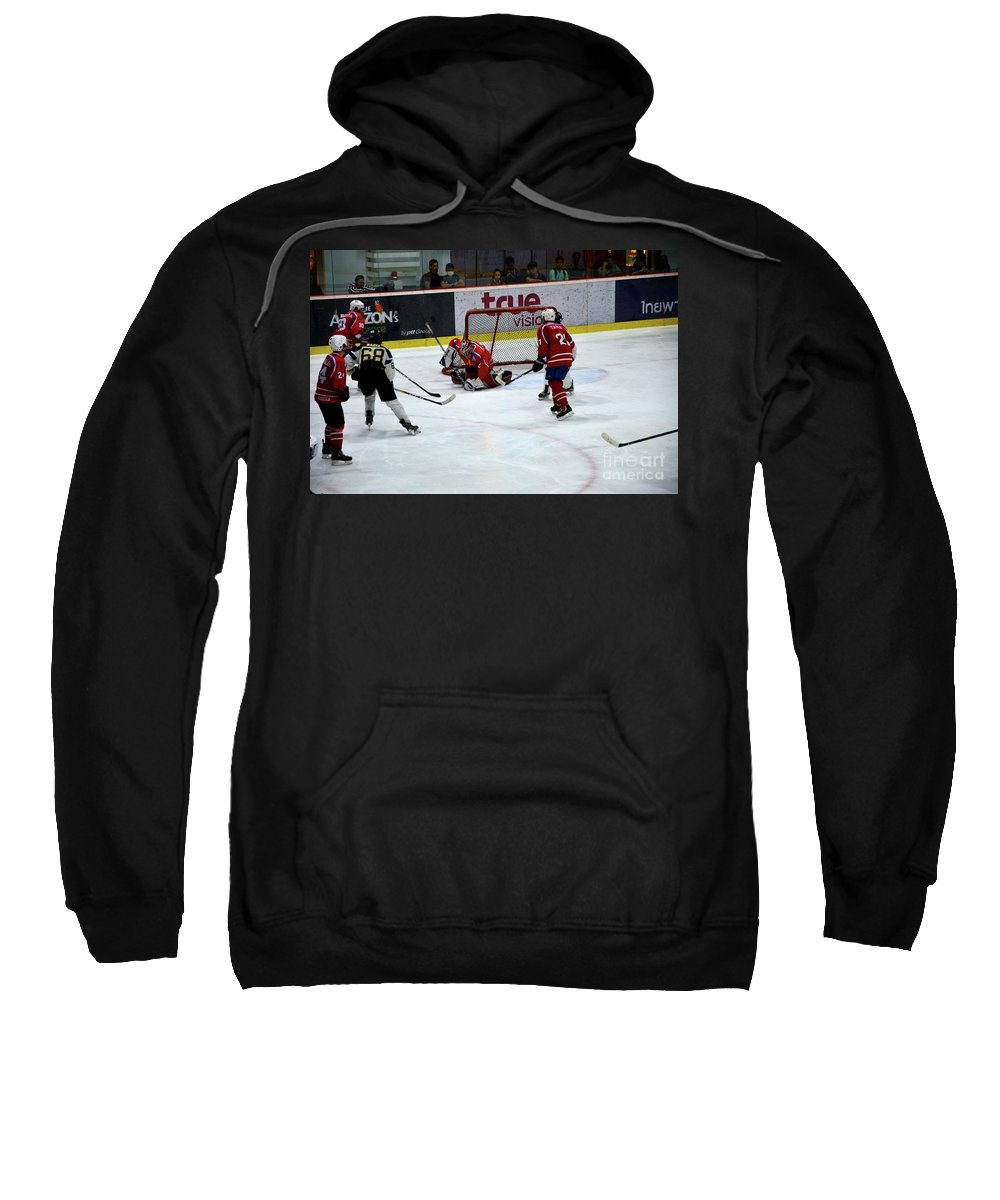 Malaysia Sweatshirt featuring the photograph Mongolia Team Players Defend Goal Vs Malaysia In Ice Hockey Match In Rink Bangkok Thailand by Imran Ahmed