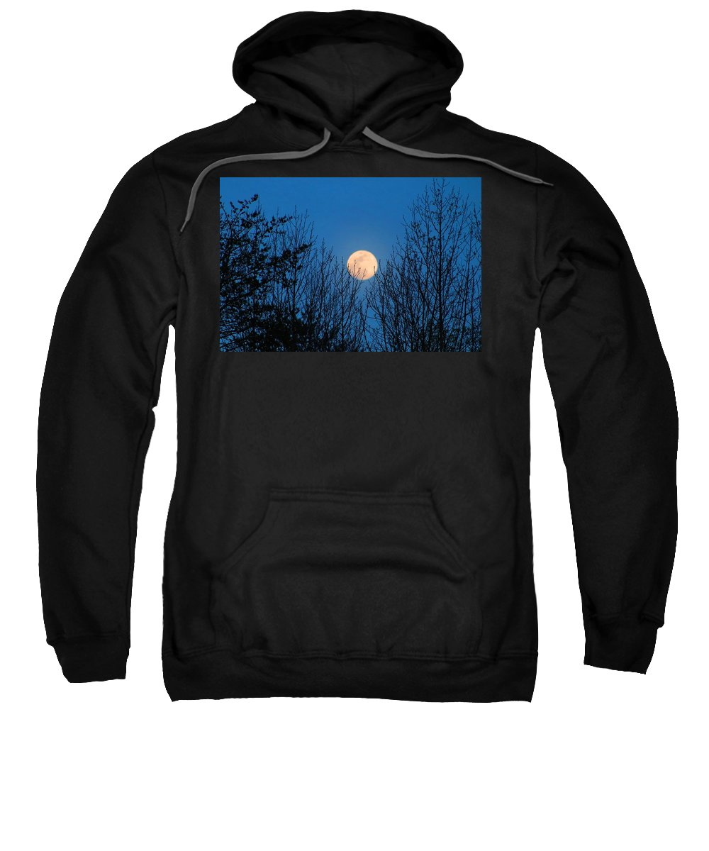 Moonrise Sweatshirt featuring the photograph Moon Rising In The Trees by Kathryn Meyer