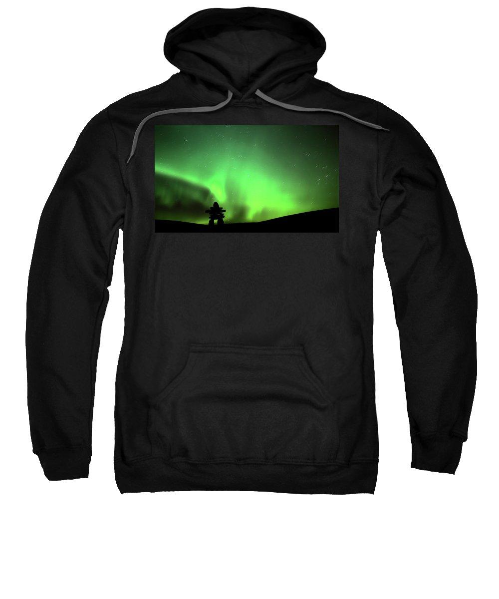Inukchuk Sweatshirt featuring the digital art Northern Light Above An Inukchuk In Saskatchewan by Mark Duffy