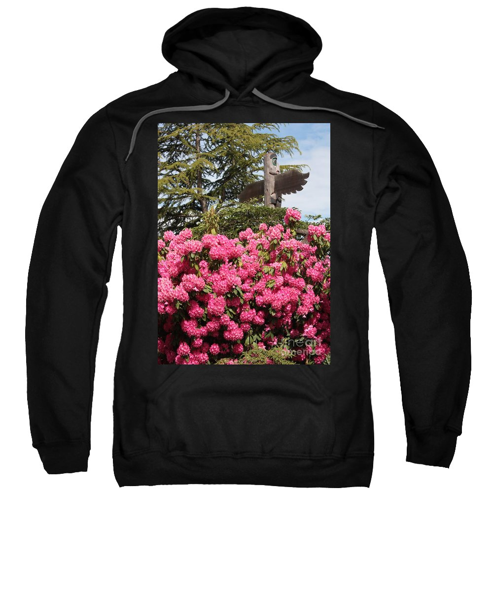 Northwest Sweatshirt featuring the photograph Pink Rhododendrons With Totem Pole by Carol Groenen
