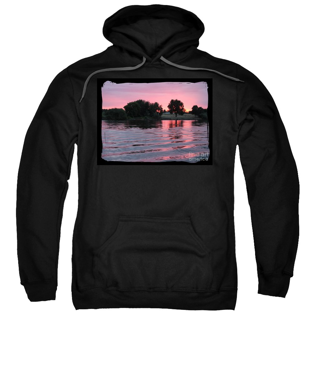 Pink Sunset Sweatshirt featuring the photograph Pink Sunset With Soft Waves In Black Framing by Carol Groenen