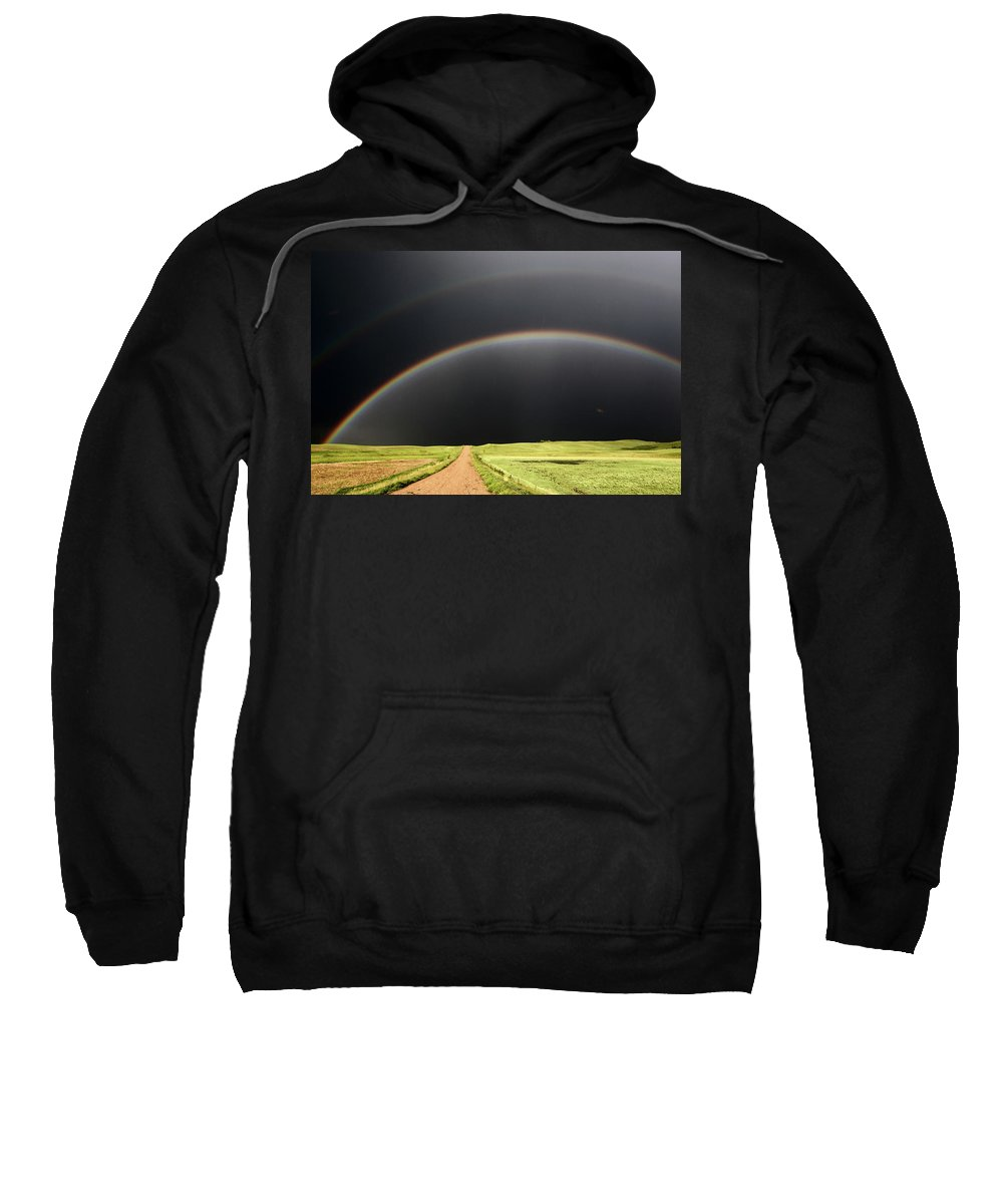 Rainbow Sweatshirt featuring the digital art Rainbow And Darkened Skies Seen Down A Country Road by Mark Duffy