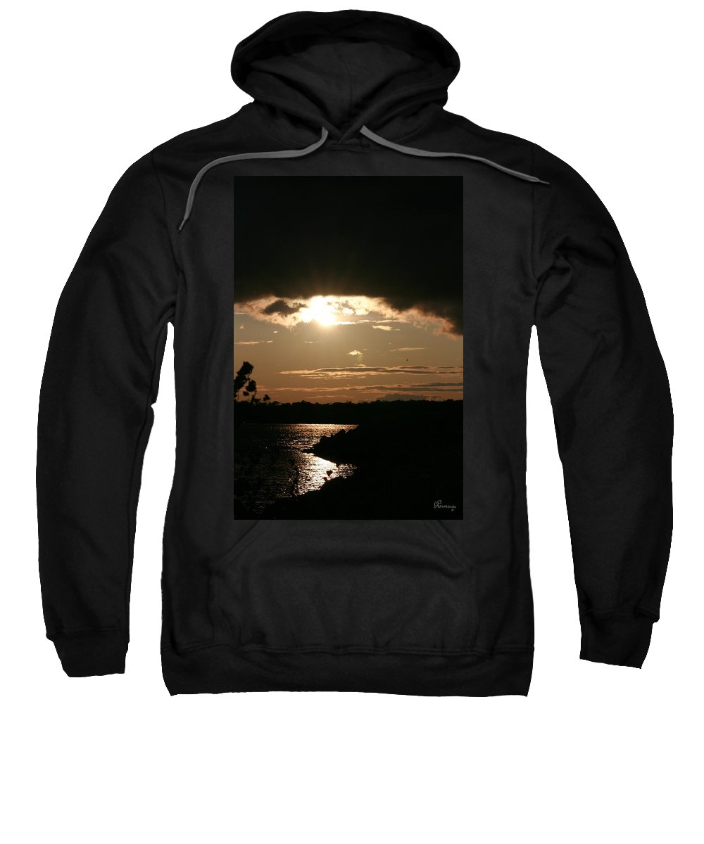 Sunset Lake Water Trees Rocks Shore Clouds Sweatshirt featuring the photograph Setting Sun by Andrea Lawrence